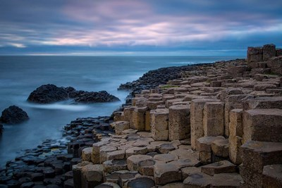 Twilight Over The Giant's Causeway, County Antrim, Northern Ireland Poster by Brian Jannsen / Danita Delimont for $47.50 CAD