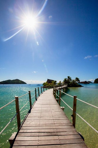 Sun over Likuliku Lagoon Resort, Malolo Island, Mamanucas, Fiji Poster by Douglas Peebles / Danita Delimont for $43.75 CAD