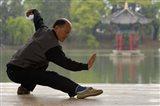 Man Doing Tai Chi Exercises at Black Dragon Pool with One-Cent Pavilion, Lijiang, Yunnan Province, China