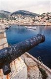 Cannon, hydrofoil boat, harbor, Hydra Island, Greece