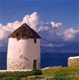 Greece, Mykonos, Windmill looks over Azure Sea