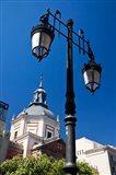 Spain, Madrid Lamppost and the dome of the Las Calatravas Church