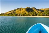 Blue boat cruising through the Yasawa, Fiji, South Pacific