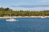 Little sailboat in the blue lagoon, Yasawa, Fiji, South Pacific