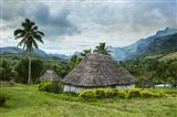 Traditional thatched roofed huts in Navala, Fiji, South Pacific