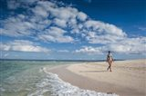 Woman walking on white sand beach of Beachcomber Island, Mamanucas Islands, Fiji
