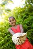 Village boy with large sea shell, Beqa Island, Fiji