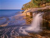 Waterfall Flows Across Sandstone Shore At Miners Beach