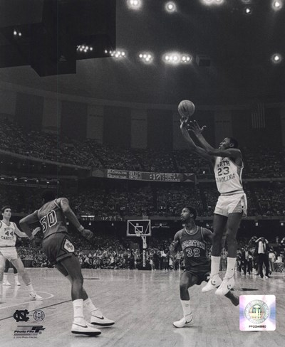 Michael Jordan University of North Carolina Game winning basket in the 1982 NCAA Finals against Georgetown Vertical Action Poster by Unknown for $23.75 CAD