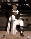 Roberto Clemente leaning on bats