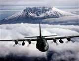 A C-130 Hercules aircraft flies over Mount St. Helens, Vancouver, Washington