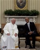 Pope Francis talks with US President Barack Obama