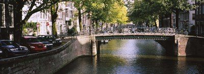 Bridge across a channel, Amsterdam, Netherlands Poster by Panoramic Images for $71.25 CAD