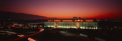 High angle view of a building lit up at night, John F. Kennedy Center for the Performing Arts, Washington DC, USA Poster by Panoramic Images for $71.25 CAD