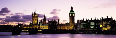 Buildings lit up at dusk, Big Ben, Houses of Parliament, Thames River, City Of Westminster, London, England Poster by Panoramic Images for $86.25 CAD