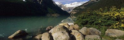 Stones at the lakeside, Lake Louise, Banff National Park, Alberta, Canada Poster by Panoramic Images for $71.25 CAD