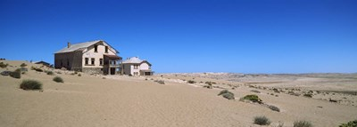 Abandoned house in a mining town, Kolmanskop, Namib desert, Karas Region, Namibia Poster by Panoramic Images for $86.25 CAD