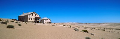 Abandoned house in a mining town, Kolmanskop, Namib desert, Karas Region, Namibia Poster by Panoramic Images for $71.25 CAD