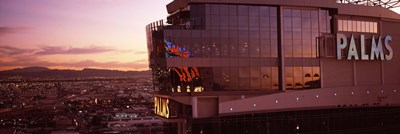 Hotel lit up at dusk, Palms Casino Resort, Las Vegas, Nevada, USA Poster by Panoramic Images for $86.25 CAD