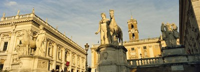 Low angle view of a statues in front of a building, Piazza Del Campidoglio, Palazzo Senatorio, Rome, Italy Poster by Panoramic Images for $71.25 CAD