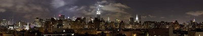 Buildings lit up at night, Empire State Building, Manhattan, New York City, New York State, USA 2009 Poster by Panoramic Images for $86.25 CAD