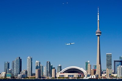 Airplane over city skylines, CN Tower, Toronto, Ontario, Canada 2011 Poster by Panoramic Images for $135.00 CAD