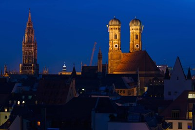Town hall with a church at night, Munich Cathedral, New Town Hall, Munich, Bavaria, Germany Poster by Panoramic Images for $141.25 CAD