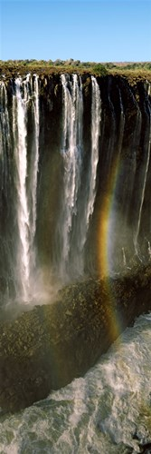 Rainbow forms in the water spray in the gorge at Victoria Falls, Zimbabwe Poster by Panoramic Images for $71.25 CAD