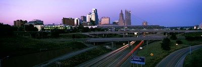 Highway interchange and skyline at sunset, Kansas City, Missouri, USA Poster by Panoramic Images for $86.25 CAD