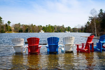 Adirondack chairs partially submerged in the Lake Muskoka, Ontario, Canada Poster by Panoramic Images for $135.00 CAD