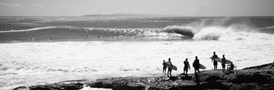 Silhouette of surfers standing on the beach, Australia (black and white) Poster by Panoramic Images for $86.25 CAD