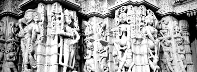 Sculptures carved on a wall of a temple, Jain Temple, Ranakpur, Rajasthan, India BW Poster by Panoramic Images for $85.00 CAD