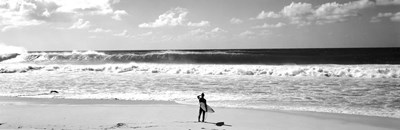 Surfer standing on the beach, North Shore, Oahu, Hawaii Poster by Panoramic Images for $78.75 CAD