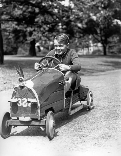 1930s Boy Driving Home In Race Car Poster by Vintage PI for $67.50 CAD