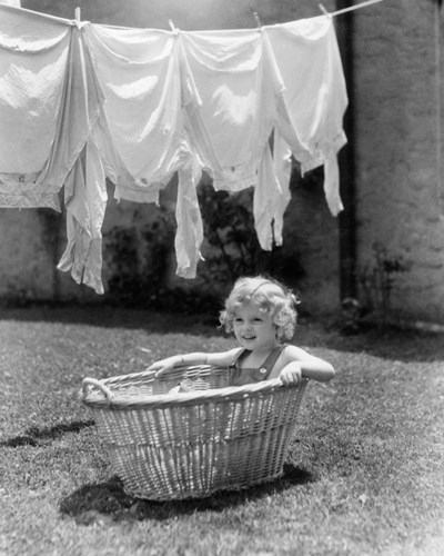 1930s 1940s Girl Outdoors Sitting In Laundry Basket Poster by Vintage PI for $56.25 CAD