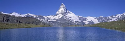 Panoramic View Of A Snow Covered Mountain By A Lake, Matterhorn, Zermatt, Switzerland Poster by Panoramic Images for $71.25 CAD