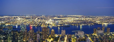 Aerial View Of Buildings Lit Up At Dusk, Manhattan Poster by Panoramic Images for $67.50 CAD