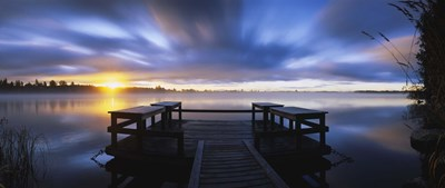 Panoramic view of a pier at dusk, Vuoksi River, Imatra, Finland Poster by Panoramic Images for $86.25 CAD