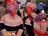 Rear view of two Flower Hmong women at a market, Bac Ha Sunday Market, Lao Cai Province, Vietnam