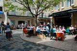 Tourists at sidewalk cafes, Lourmarin, Vaucluse, Provence-Alpes-Cote d'Azur, France
