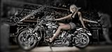 Female model with a motorcycle in a workshop