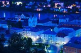 High angle view of old town buildings at night, Passau, Bavaria, Germany