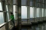 Person viewing a city from observation point in a tower, Jin Mao Tower, Lujiazui, Pudong, Shanghai, China
