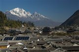 High angle view of houses with Jade Dragon Snow Mountain in the background, Old Town, Lijiang, Yunnan Province, China