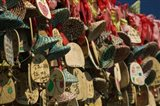 Buddhist prayer wishes (Ema) hanging at a shrine on a tree, Old Town, Lijiang, Yunnan Province, China