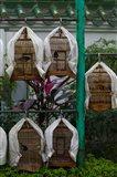 Birds in cages for sale at a bird market, Yuen Po Street Bird Garden, Mong Kok, Kowloon, Hong Kong
