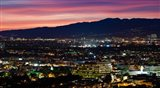 High angle view of a city at dusk, Culver City, West Los Angeles, Santa Monica Mountains, Los Angeles County, California, USA
