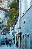 Tourists walking in the street of lower town, Rocamadour, Lot, Midi-Pyrenees, France