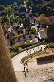 Elevated view of a village with Chateau de Castelnaud, Castelnaud-la-Chapelle, Dordogne, Aquitaine, France