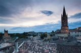 Elevated view of a town with Eglise Monolithe church at dusk, Saint-Emilion, Gironde, Aquitaine, France